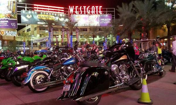 A cluster of motorcycles parked at Westgate Entertainment District in Glendale AZ.
