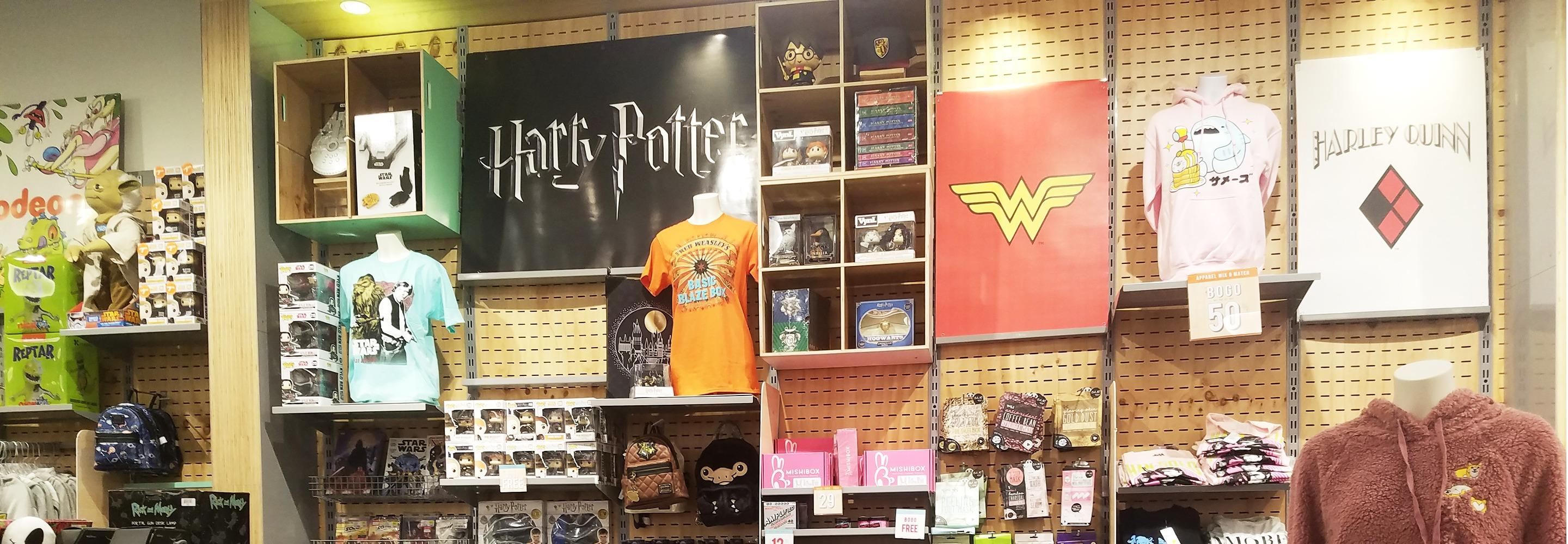 Pop Culture wall featuring Harry Potter and Wonder Woman in FYE