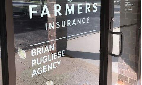 Front door decal reading Farmers Insurance Brian Pugliese Agency.