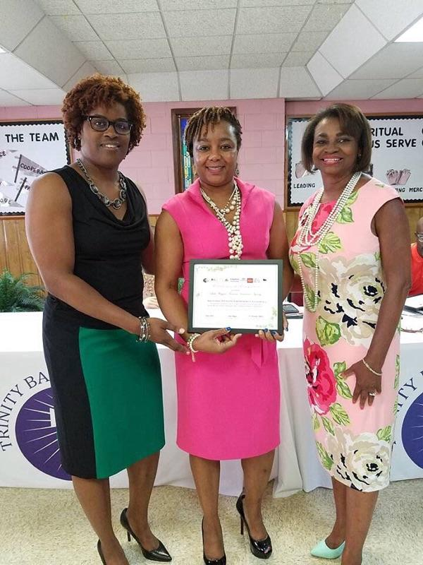 Tammy Fincher, President of CEAF, Inc.; Leah Wiggins, LUTCF and Dr. Gwendolyn Tilghman
