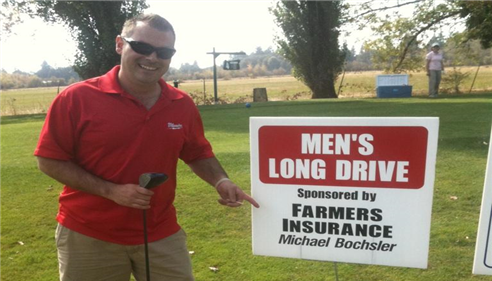 man standing with a Farmers insurance sponsorship sign