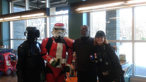 "Assisting with donation drive for the Memphis Food Bank. ""May the force be with you!"""