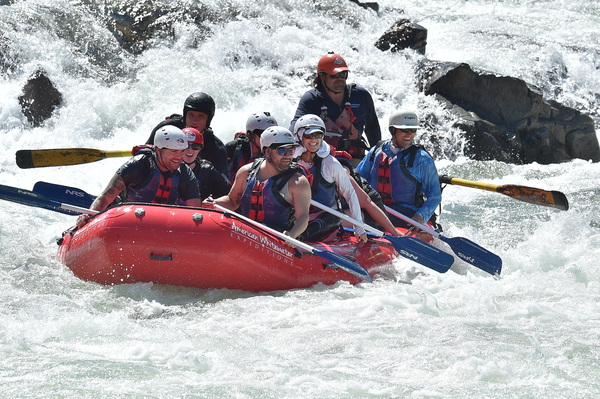 People in raft going downstream