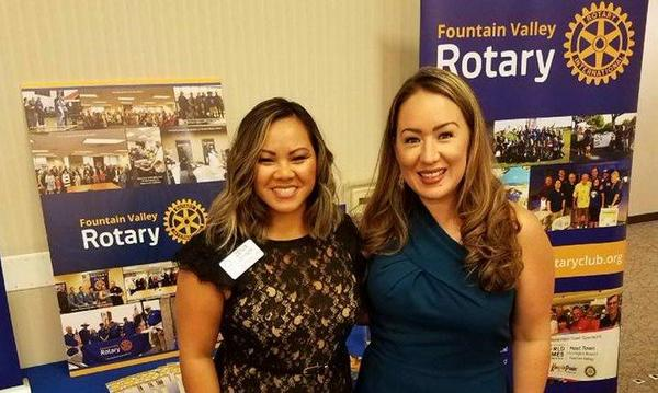 Agent Melissa Watanabe with community member and local business owner Zenia Joyner at a fundraiser