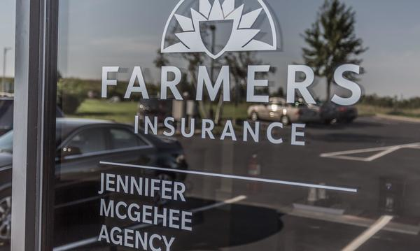 Glass door with Farmers logo