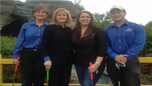agency staff at a putt-putt game.