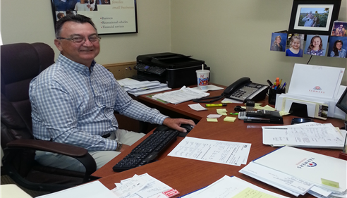 Ed DeBoer in the office handling home and auto insurance for our clients.
