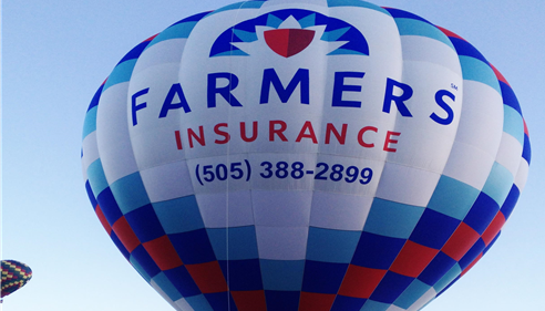 Farmers Insurance hot air balloon with the phone number (505) 388-2899