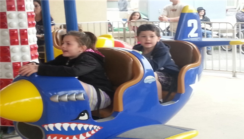 My duaghter and son enjoying one of the many rides at Knoebels Amusement Park
