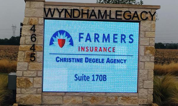 A sign that reads, Farmers Insurance Christine Degele Agency Suite 170B