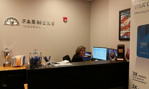 Matt North Agency staff member Cindy Erickson at the front desk of the office.