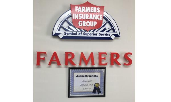 A Farmers Insurance Customer Service Representative of the Month Award for Aseneth Coheto.