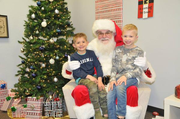 Debbie's kiddos on Santa's lap during our 2nd Annual Cookies & Cocoa with Santa event.
