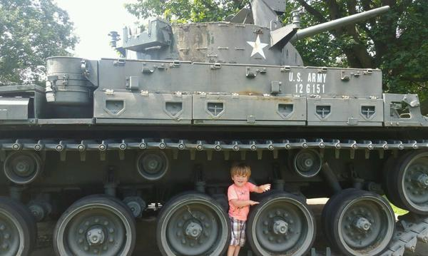 My grandson standing next to a WWII tank!