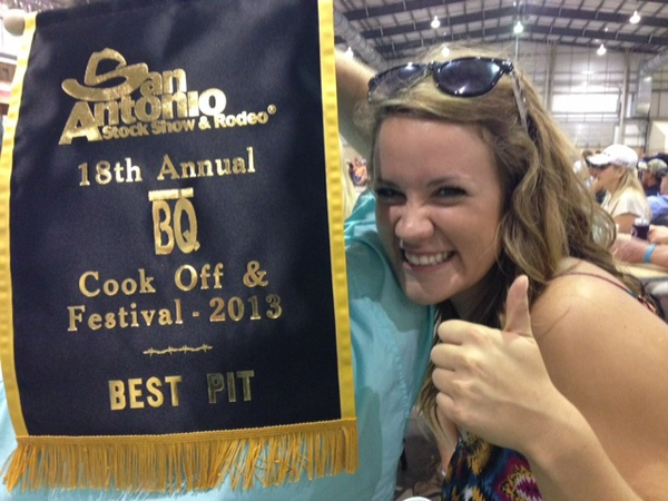 woman holding cook off festival award for best pit