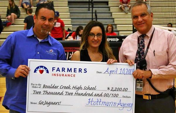 Photo at Creek HS check presentation