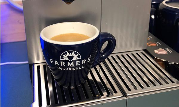 Coffee in a Farmers® Insurance mug.