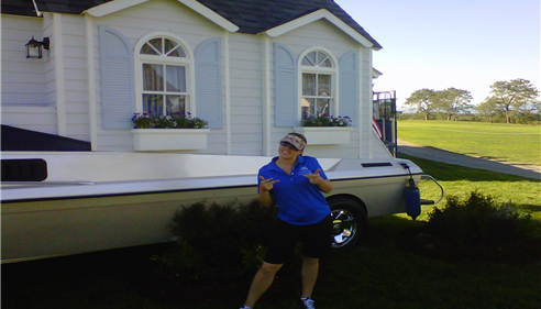 Jill at the Farmers® Insurance Open with the Auto-boat-home. It really exists.