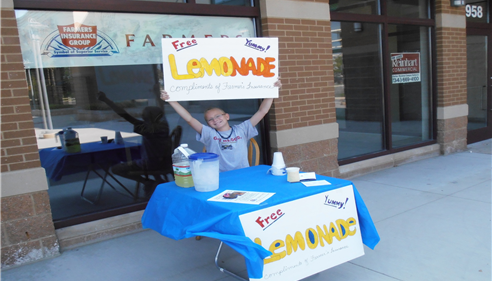 Keeping Folks cool with ice cold lemonade on a hot day!