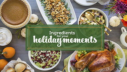 "Table full of Thanksgiving foods.  ""Ingredients for your holiday moments."""