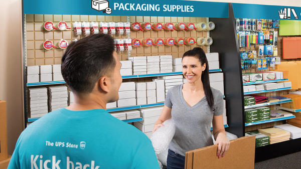 packaging supplies being handed to customer