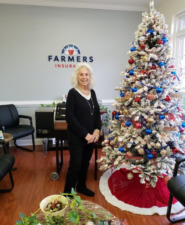 Photo of agent next to Christmas Tree