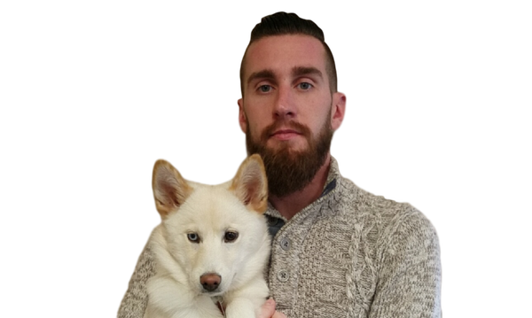 Photo of agent and his white husky
