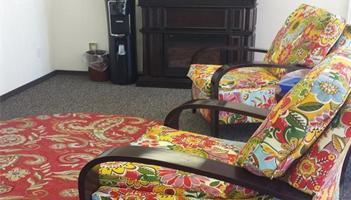 Our amazing bright and vibrant Office Chairs - right next to our coffee bar!