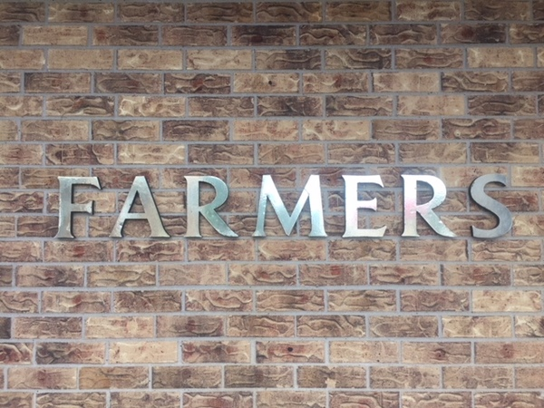 Farmers sign on the outside of the office