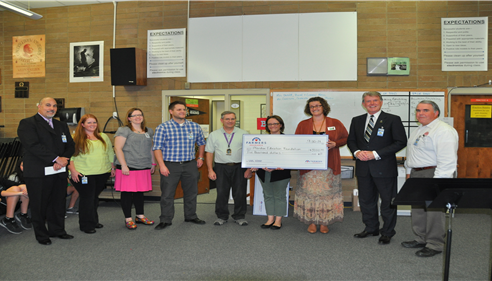 Farmers® Insurance presenting Meridian Education foundation with $5000.