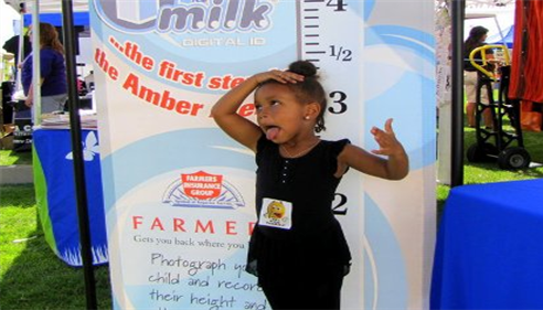 Photo of a young girl at a Farmers event