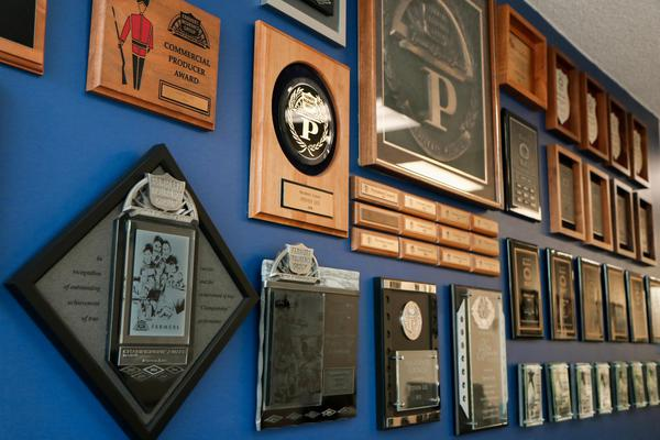 Blue wall featuring many awards