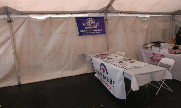 Farmers Insurance table at a local festival