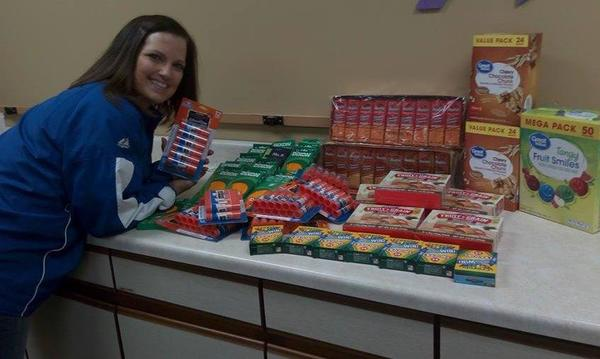 Elementary School student posing with donated snacks