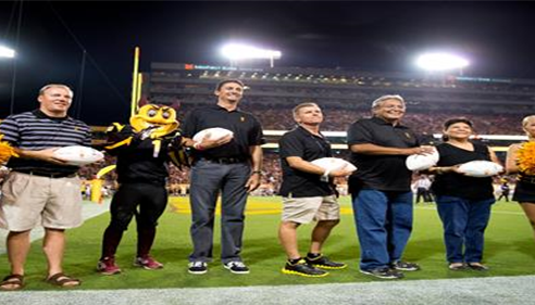 Accepting the game ball for Farmers® at the ASU vs. Wisconsin game Sept. 2013