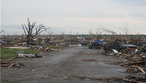Debris on streets after tornado hit Joplin, Missouri