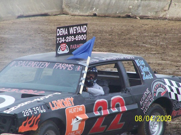 Photo of derby car with advertising on top for the agency.