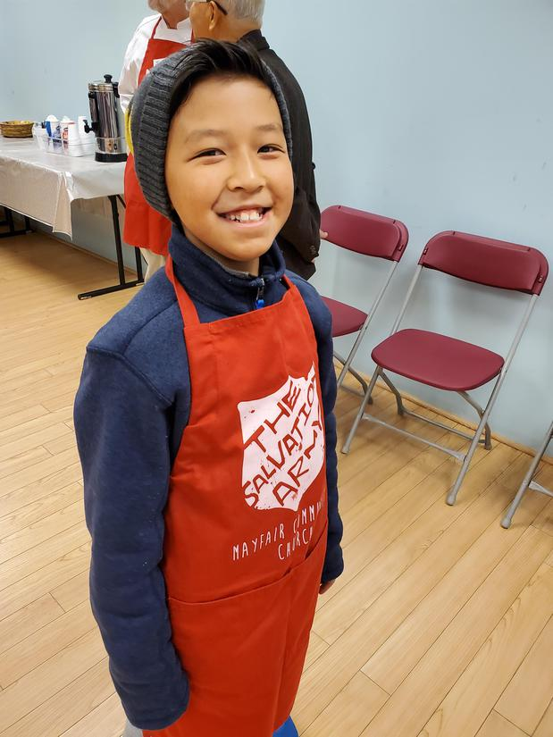 Child in apron smiling
