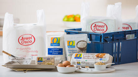 Jewel Osco Grocery bags, delivery box and groceries such as eggs, flour and cream.