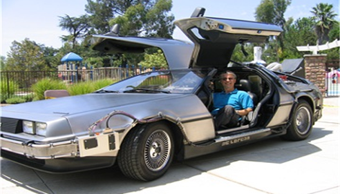 "Agent Robert Steagall in a replica of the DeLorean car from the movie ""Back to the Future."""