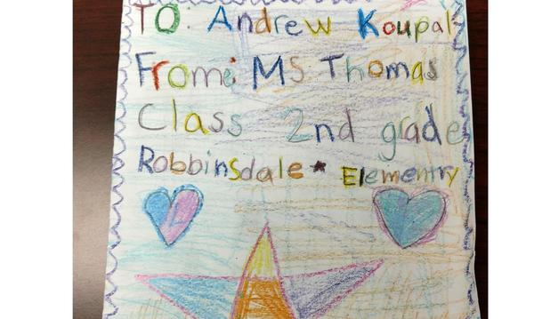A photo of a card drawn by schoolchildren for Andrew Koupal
