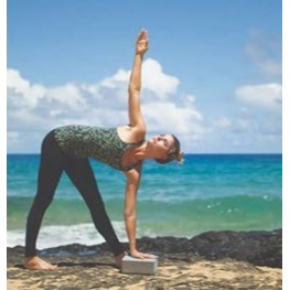 A woman doing yoga in Cariloha clothing