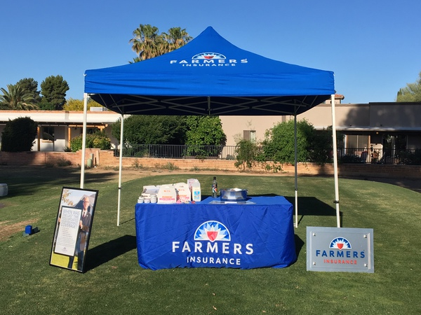 Blue Farmers booth on a golf course.