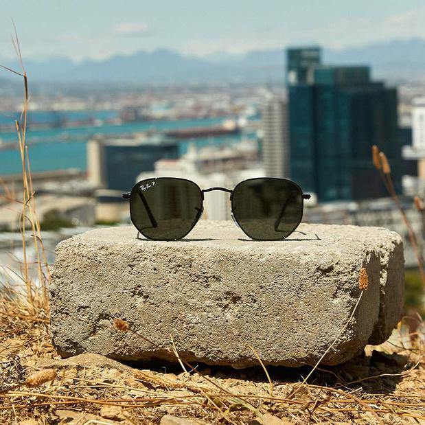 Ray-Ban sunglasses with city in background