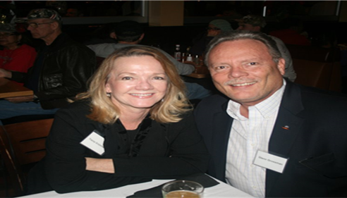 Tracey and Glenn Grossman at a Farmers® District Event, 2013!